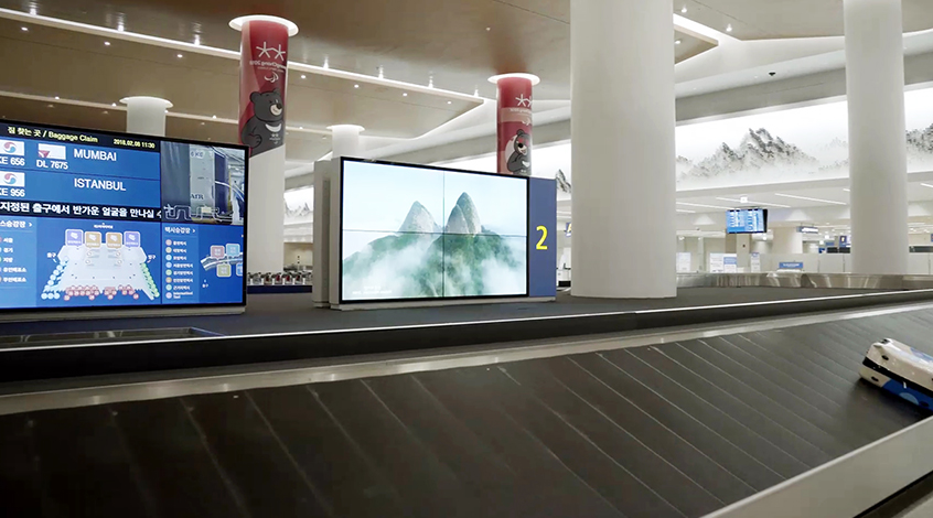 55-inch Video Walls tiled together in Baggage Claims