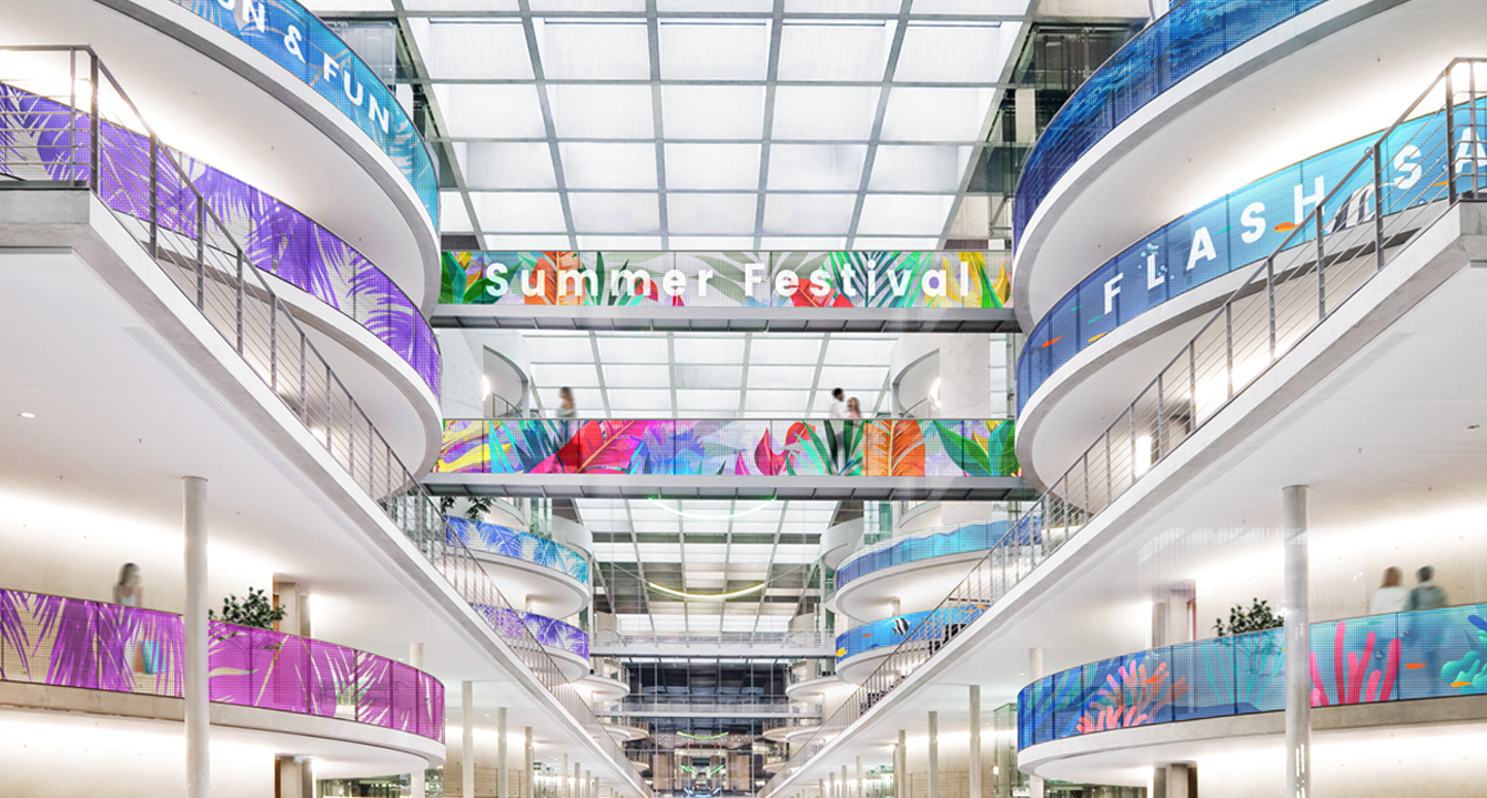 This shopping mall railing image shows that the LG Transparent LED film can be curved up to 2,000R convex and concave for curved glass or window applications.