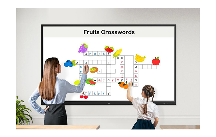 A teacher and a child are solving crosswords puzzles on the display together, using the Stylus Pens.