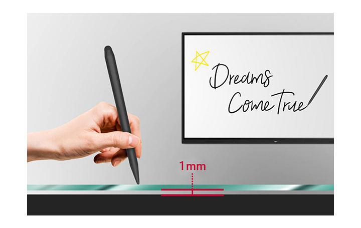 The user writes the words 'Dreams come true' with the electronic pen on the TR3DJ with 1mm gap between the screen and tempered glass.