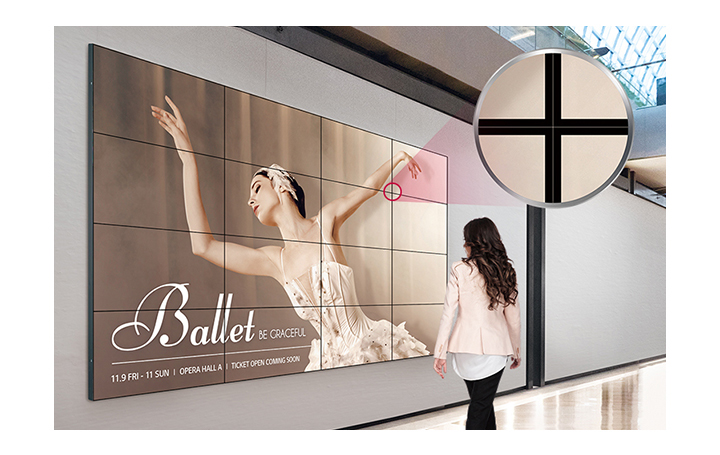 The ultra-narrow bezel screens are attached to the wall in the form of tiles, displaying large and dynamic content.