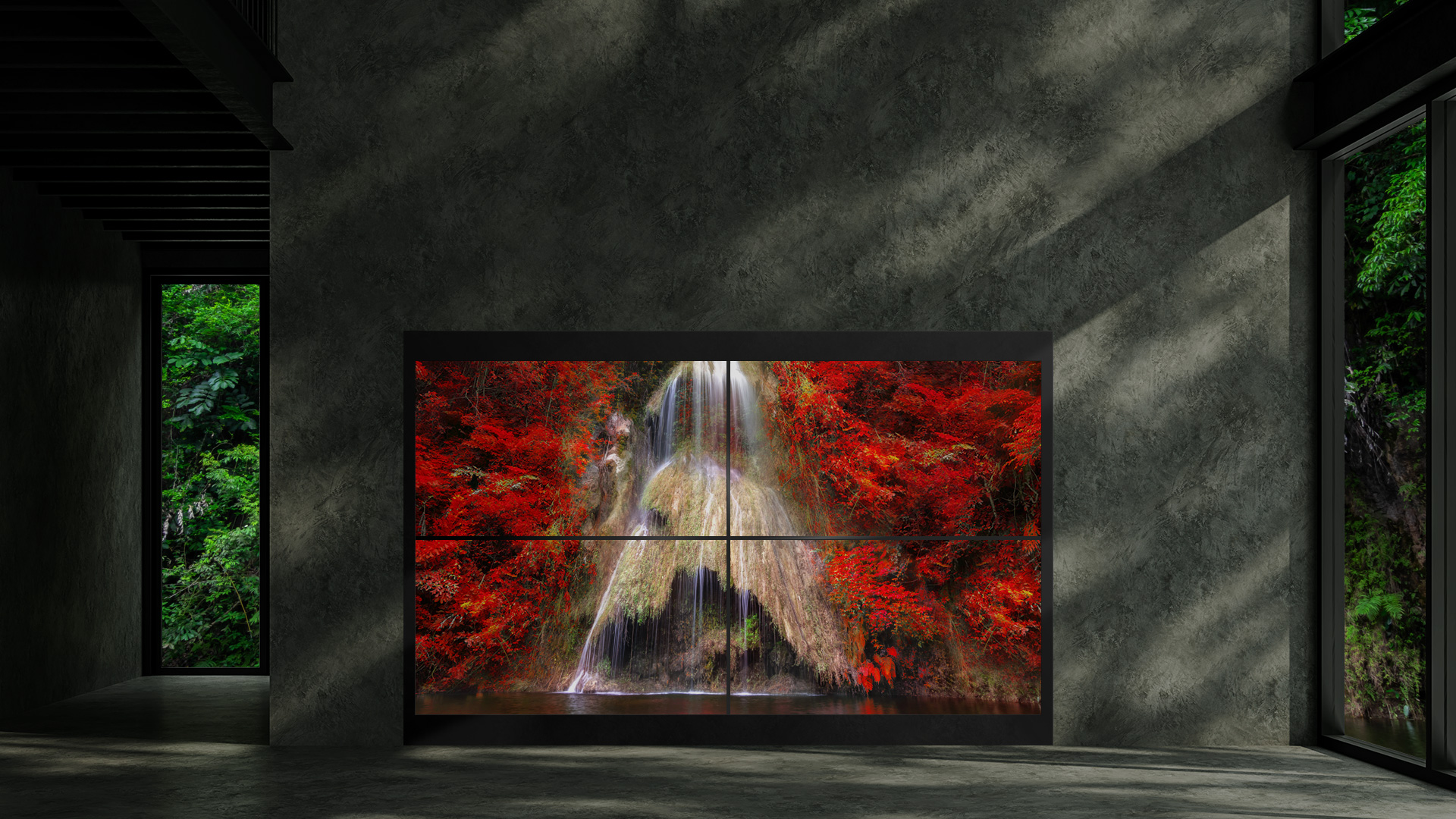 Single Transparent OLED signage displaying an imagery of mountain tree leaves turning into red with the view of the waterfall in the middle.
